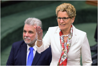 Description : ntario Premier Kathleen Wynne thanks Quebec Premier Philippe Couillard for his speech at Queen's Park in Toronto on May 11. They'll meet again on Friday - along with their cabinets.